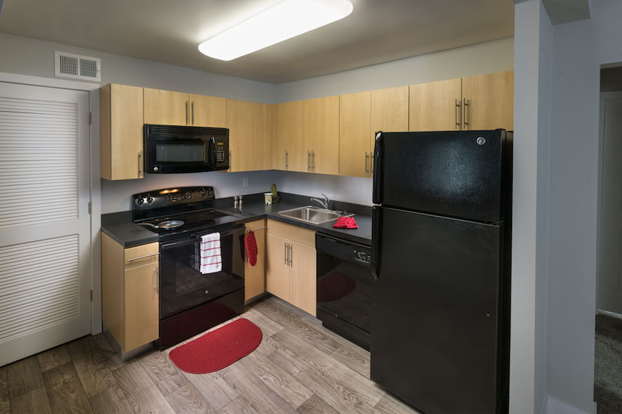 modern kitchen with black appliances in a New Castle DE apartment at Castlebrook