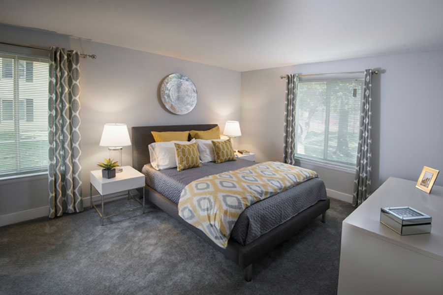 master bedroom decorated with yellows and grays in a Newark DE apartment
