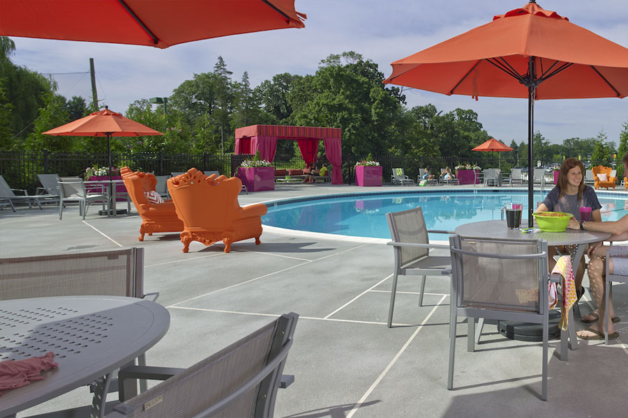 Jenkintown PA apartment swimming pool area with bright colored umbrellas and furniture