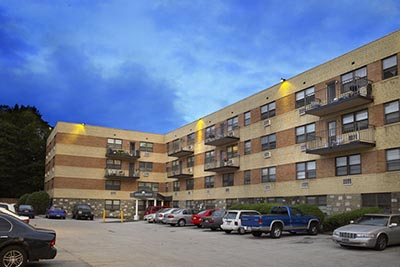 Parking lot and outside view of Chestnut Terrace Mt. Airy apartments for rent - Galman Group