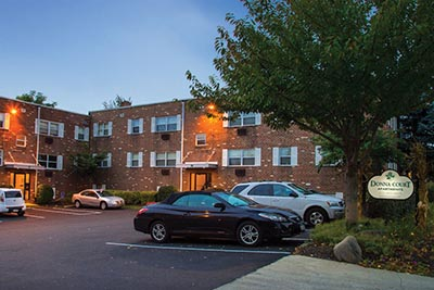 Parking lot view of Donna Court Philadelphia Mt. Airy apartments - Galman Group