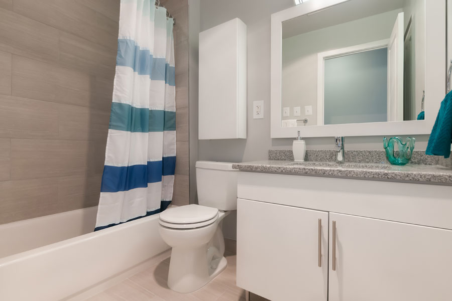 new bathroom designed with white nuetral white cabinets at the Whitney Apartments in Claymont DE