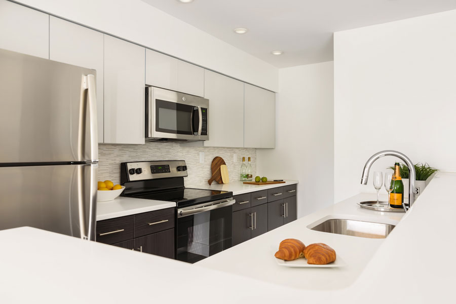 bright modern kitchen with microwave and electric range stove in an apartment at Edge of Yardley