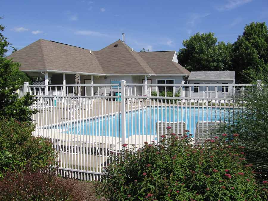 Brookstone Condominium Association pool with surrounding gate