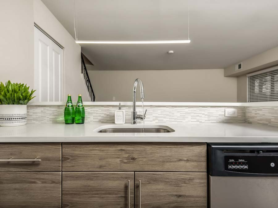 updated sink and countertop in a Newark DE townhouse at Buckingham Place