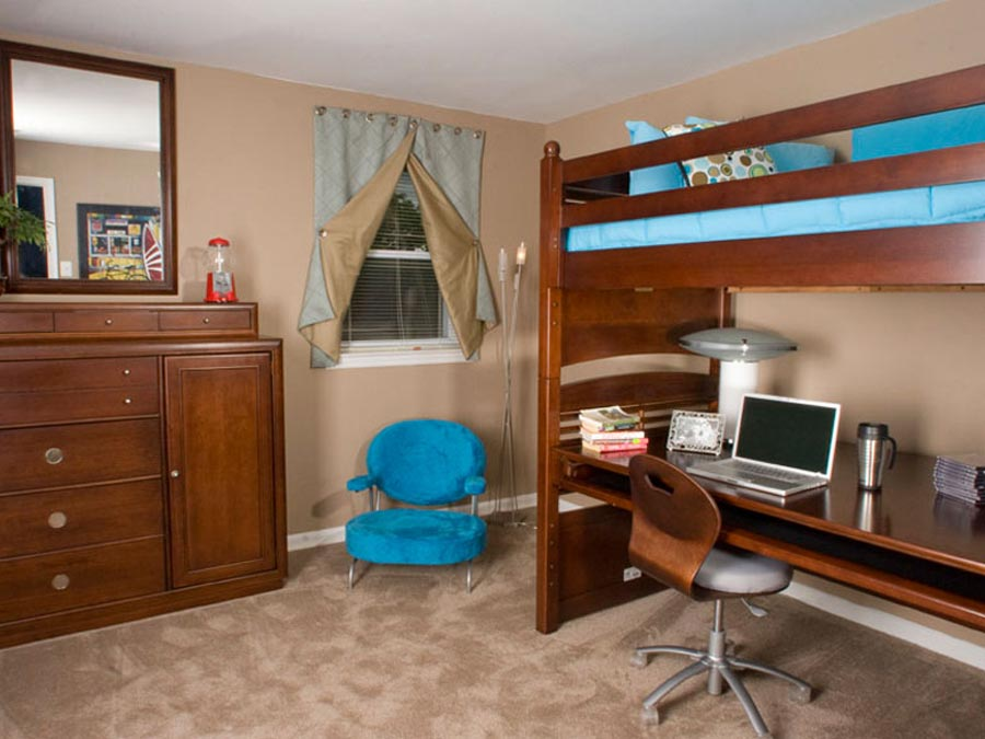 a loft bed and desk in a furnished corportate housing option at Castlebrook apartments in New Castle DE