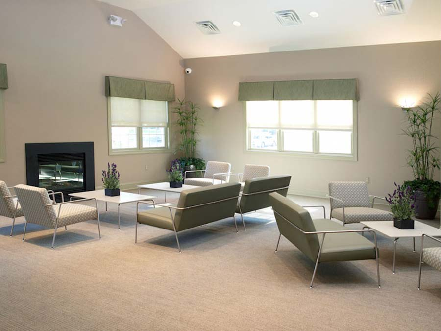 relaxing clubhouse with a fireplace and community sitting area at the Castlebrook Apartments in New Castle DE