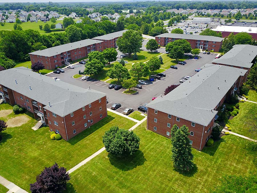 a bird's-eye-view of multiple apartment buildings and large parking lot at Castlebrook in New Castle DE