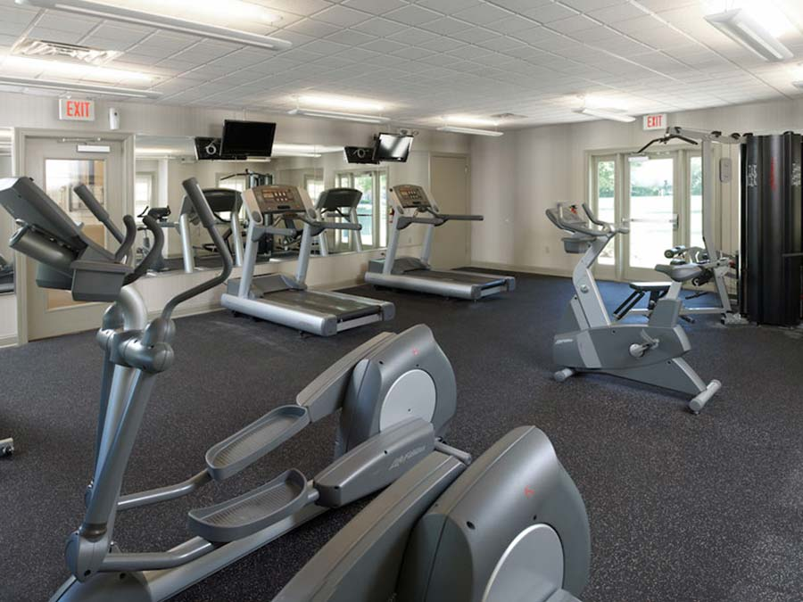 Large fitness center and cardio equipment at New Castle DE apartments at Castlebrook