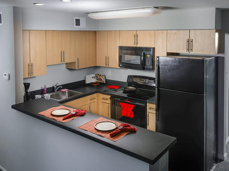 updated kitchen with breakfast bar in the Castlebrook apartments in New Castle DE