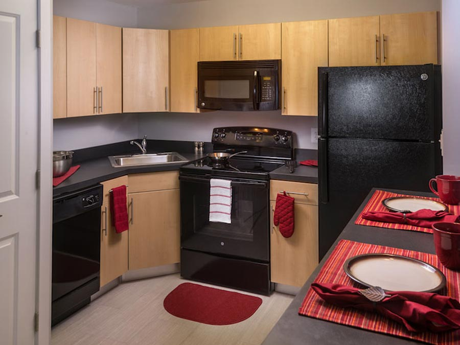 kitchen with dishwasher, microwave and breakfast bar in the Castlebrook Apartments in New Castle DE