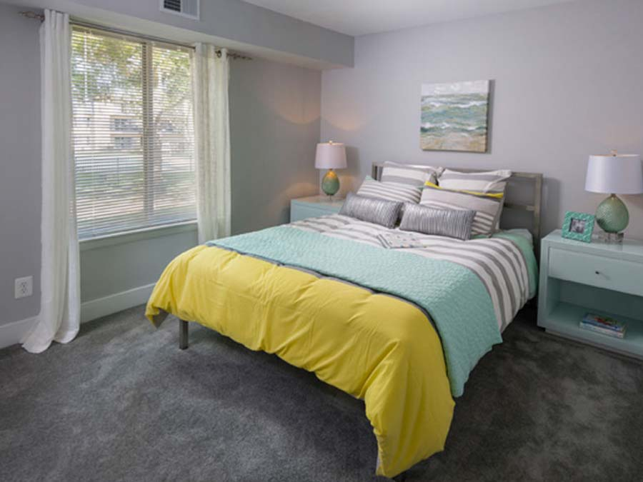 Newark DE apartment bedroom decorated in bright blues and yellows