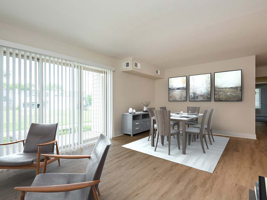 Dining area and large sliding doors to patio in a Newark DE apartment