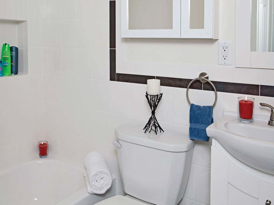 white bathroom in an apartment at Donna Court
