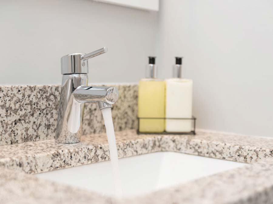 close up of sink with tasteful countertop in the Donna Court apartment near Roxborough Manayunk