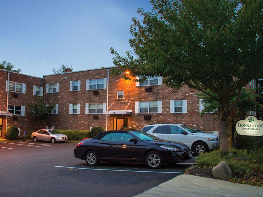 exterior of the parking lot and buildings at Donna Court apartments in Roxborough Manayunk