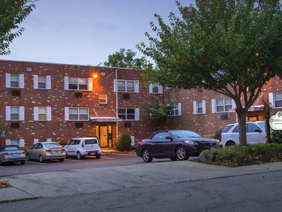 exterior street view of the parking lot and apartment building at Donna Court in Roxborough Manayunk