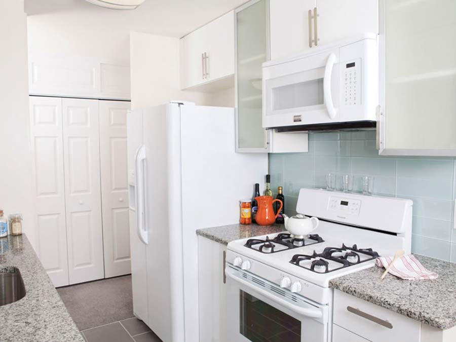 DuPont Towers kitchen with white appliances