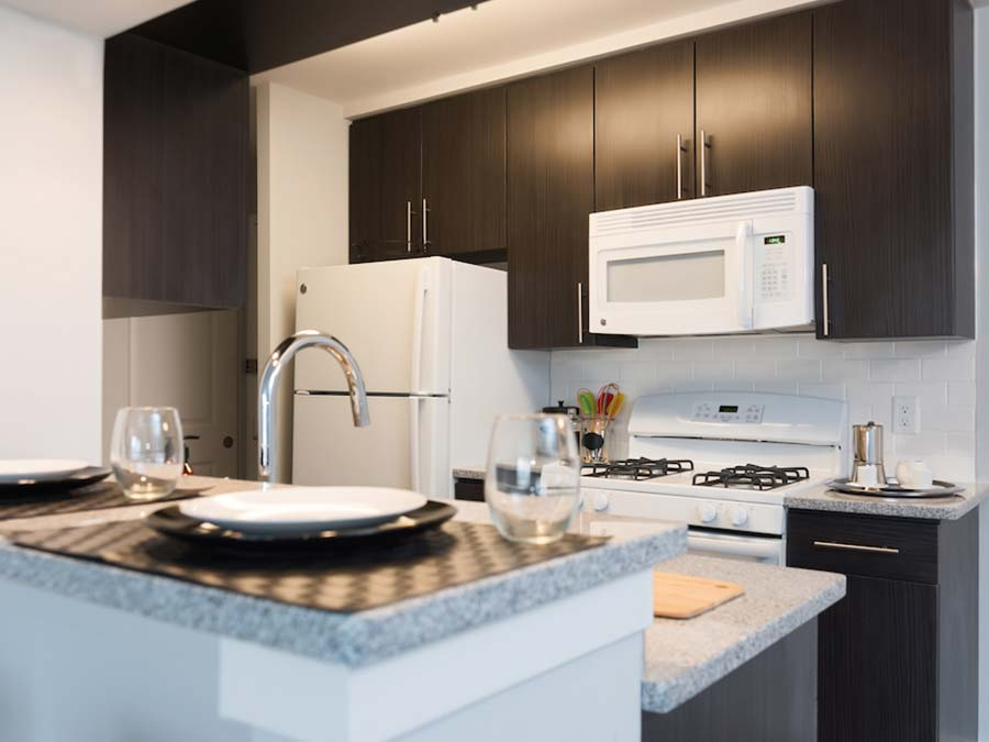 DuPont Towers with white appliances and updated cabinetry