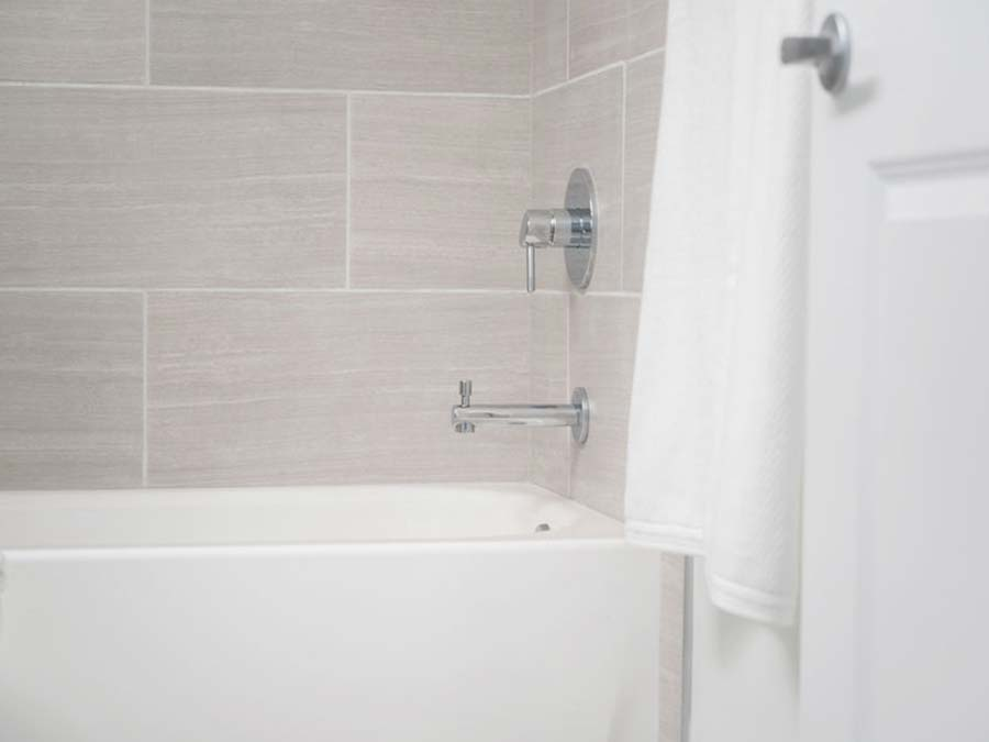 updated bathrooms with tasteful neutral tiling and fixtures in an apartment for rent