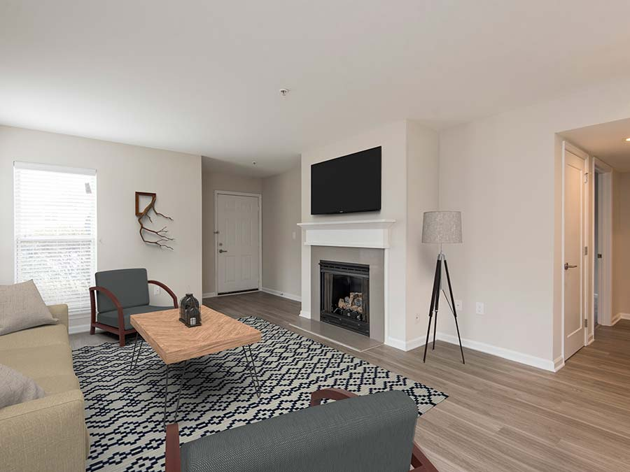 spacious farmhouse style living room in an apartment at Edge of Yardley