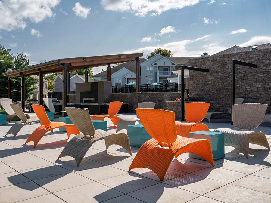 Edge of Yardley apartment outdoor community space features a sundeck and barbecue area