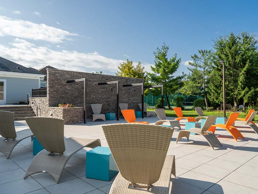 trendy and bright blue and orange outdoor furniture on the sun deck at Edge of Yarley in Yardley PA