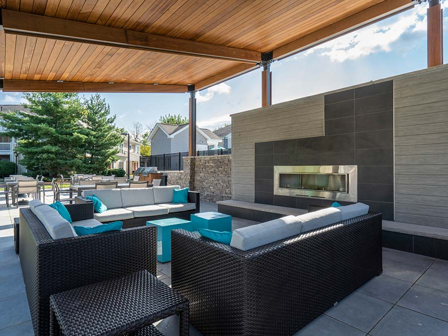 inviting blue outdoor furniture and fireplace in a community outdoor space at Edge of Yardley in Yardley PA