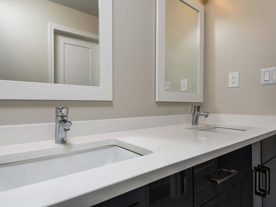 double vanity sink and lots of storage space in an apartment bathroom