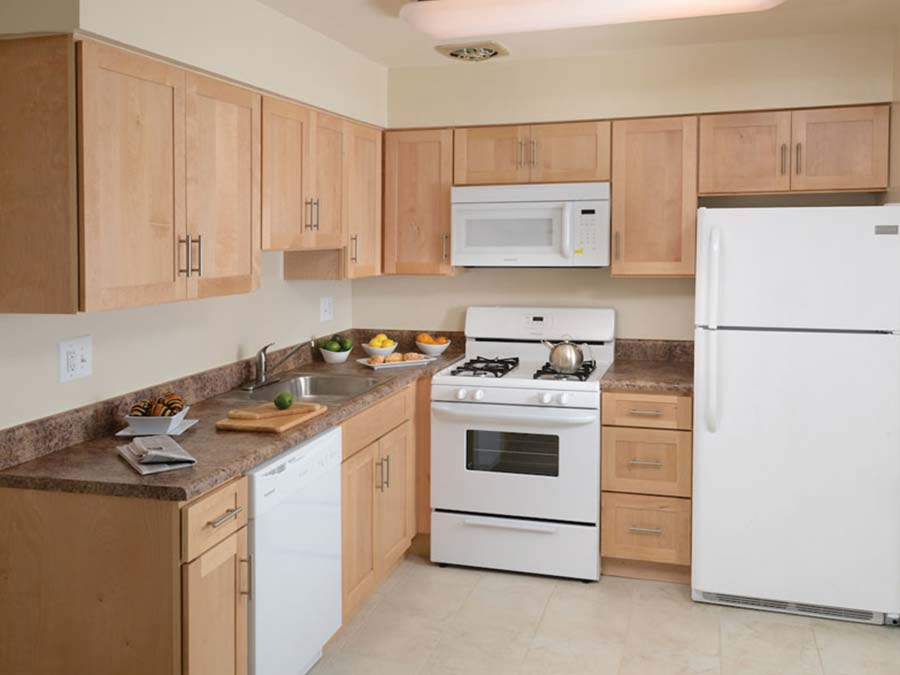 Forest Station kitchen with white appliances