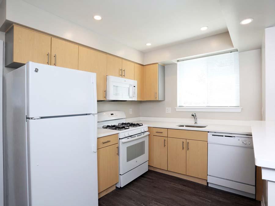 Gail Court Apartments kitchen with white appliances