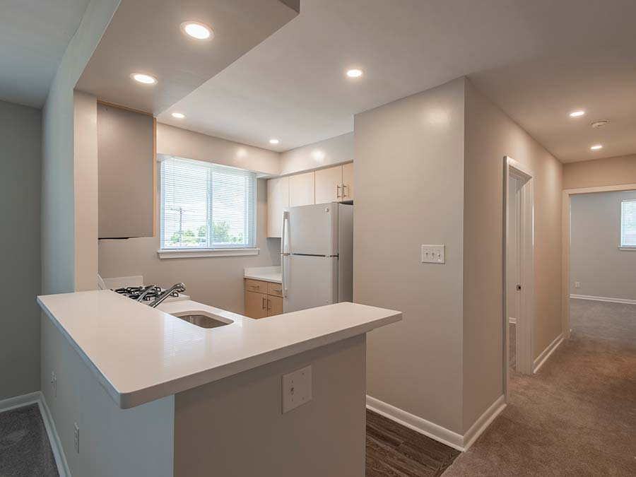 Gail Court Apartments interior kitchen with white appliances and breakfast bar