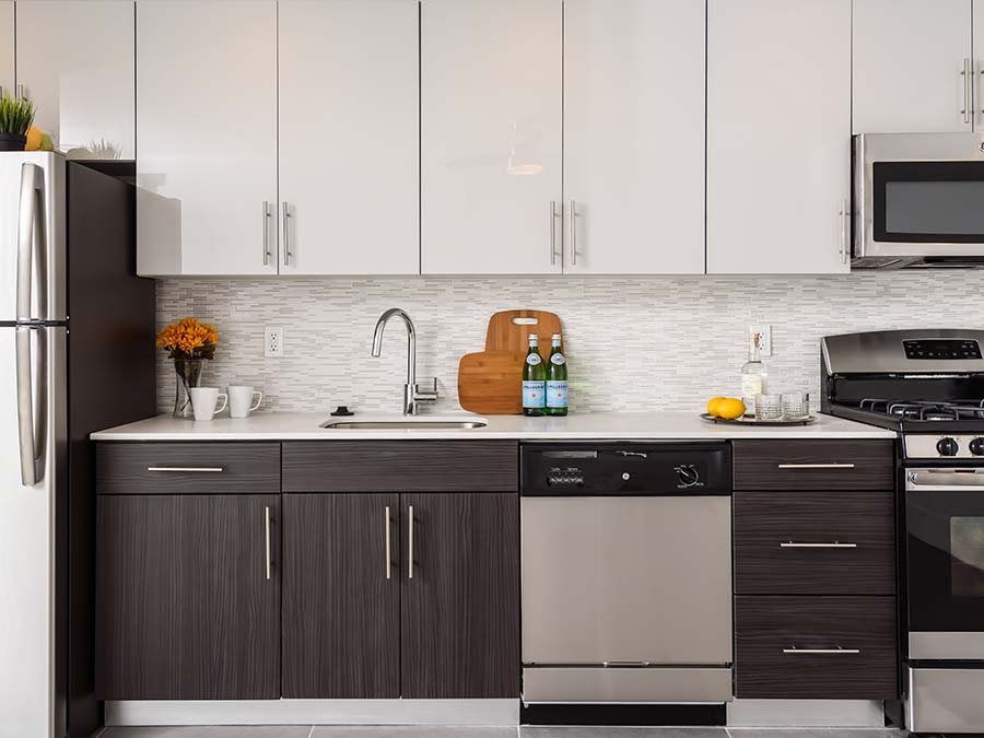 Green Valley Manor upgraded kitchens with dark cabinetry