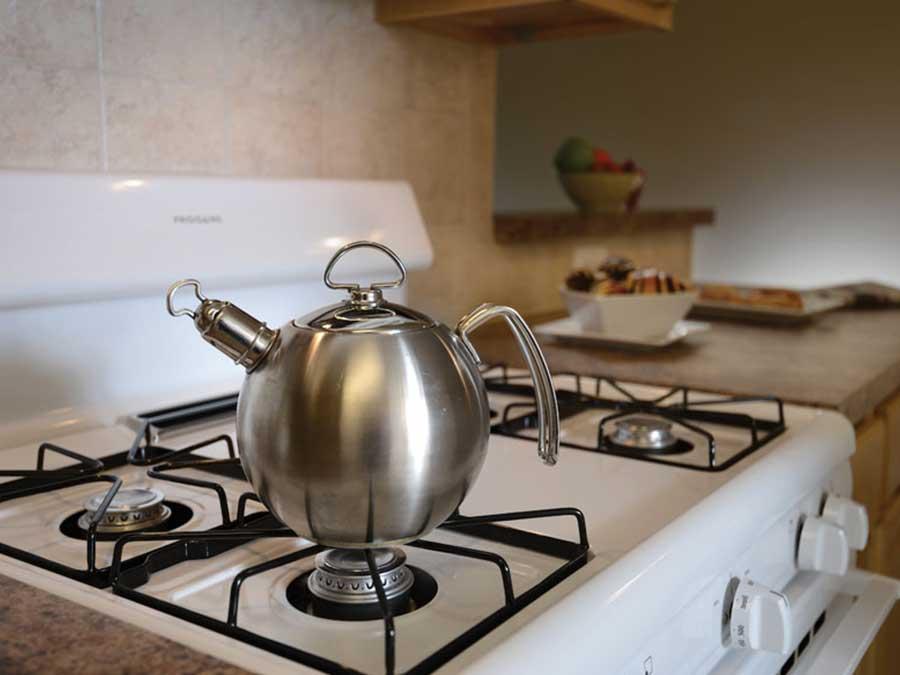 Hampton Gardens kitchen with tea kettle on stove