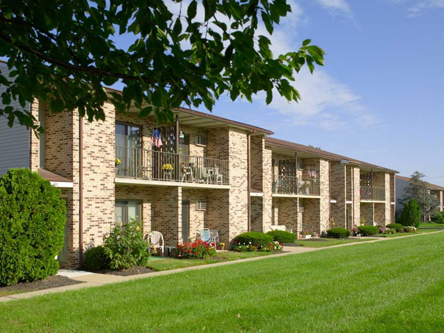 Hillside Apartments exterior building with patios and balconies