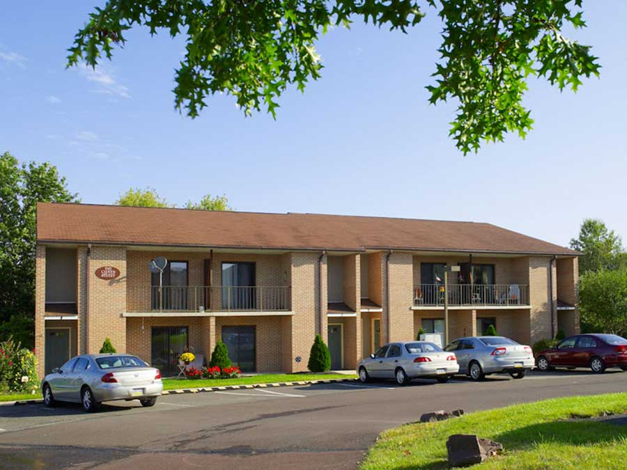 Hillside Apartments exterior building and parking area