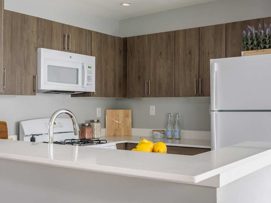 Longford Apartments kitchen with white appliances