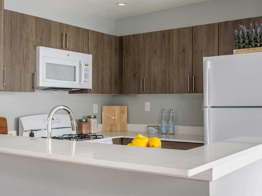 Longford Apartments kitchen with white appliances