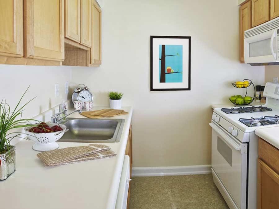Montgomery Court kitchen with white appliances