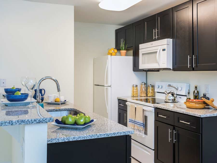 Updated kitchen with white appliances at 265 Flats apartments in Mt. Airy