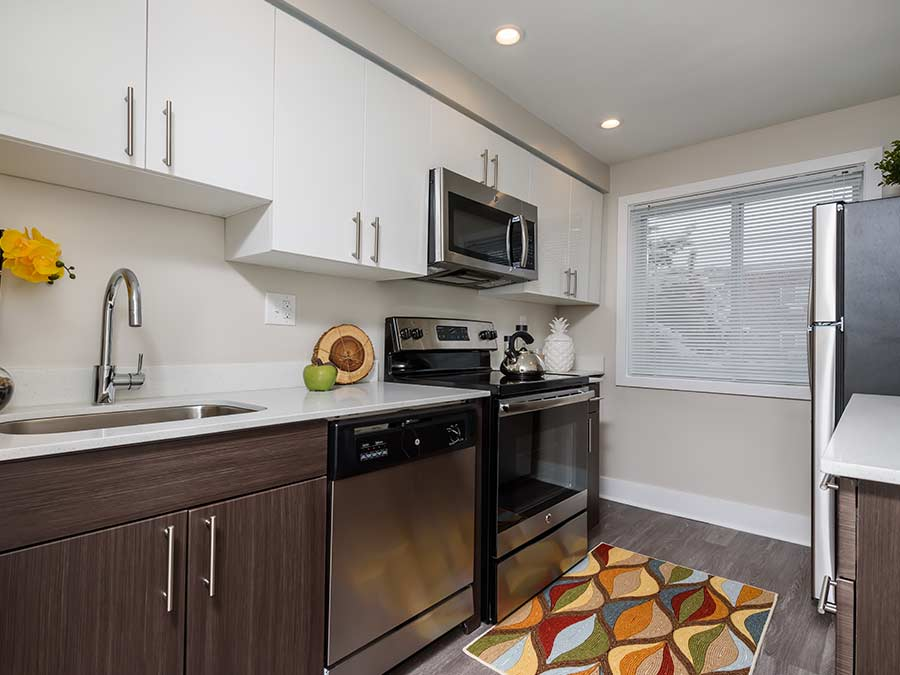 North Lane Apartments kitchen with stainless steel appliances