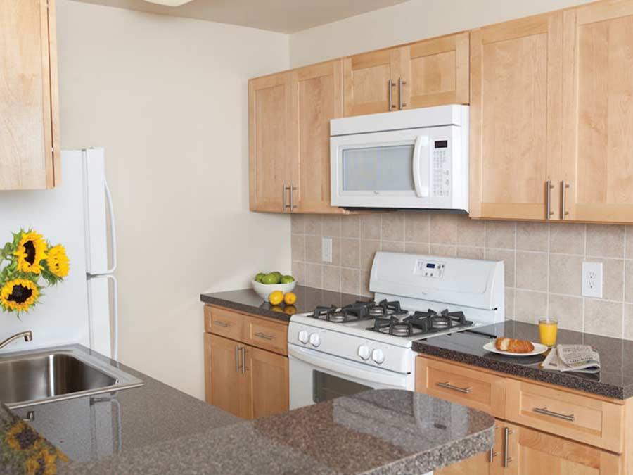 Pine Manor kitchen with white appliances