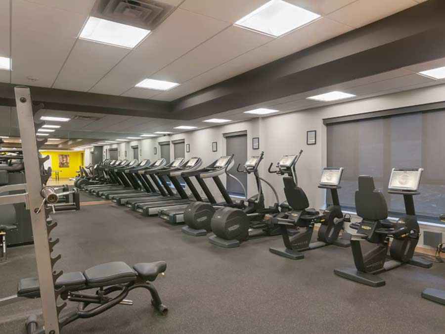Regency Towers Fitness Center with treadmills and free weights