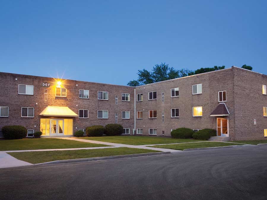 The Ridge Apartments building exterior at dusk