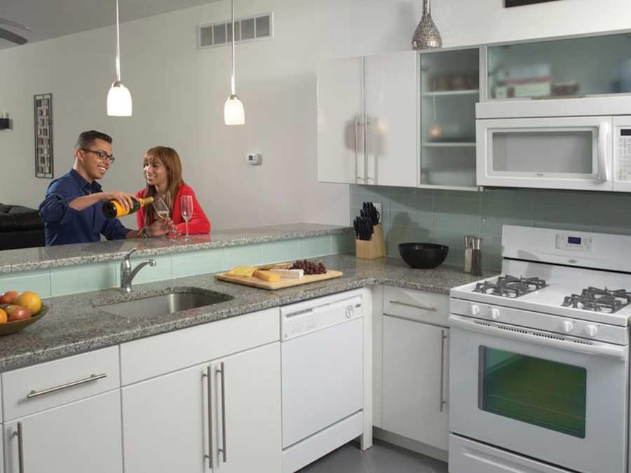 Ridgeview Apartments couple enjoying wine in the kitchen