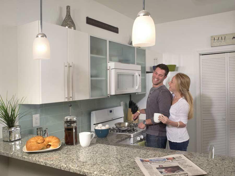 Ridgeview Apartments couple preparing dinner in kitchen