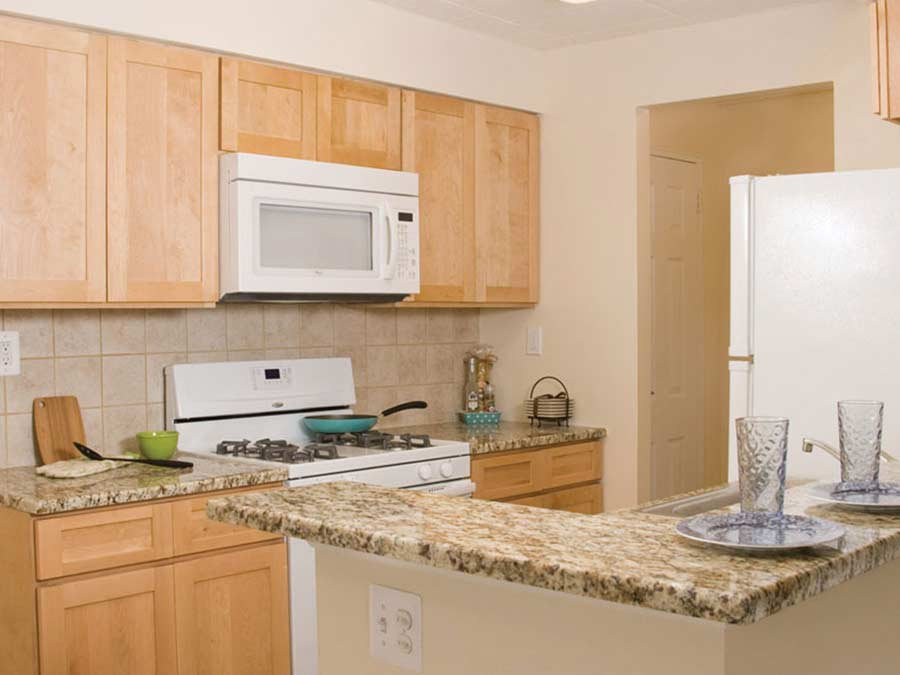 Ridgeview Apartments kitchens with white appliances
