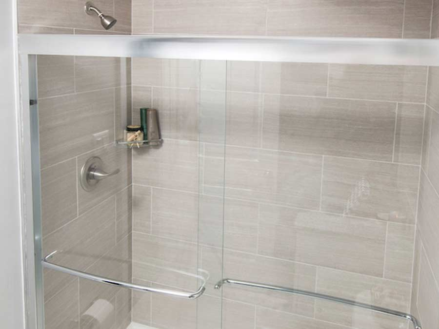 Rock Hill Apartments bathrooms with sliding glass door showers
