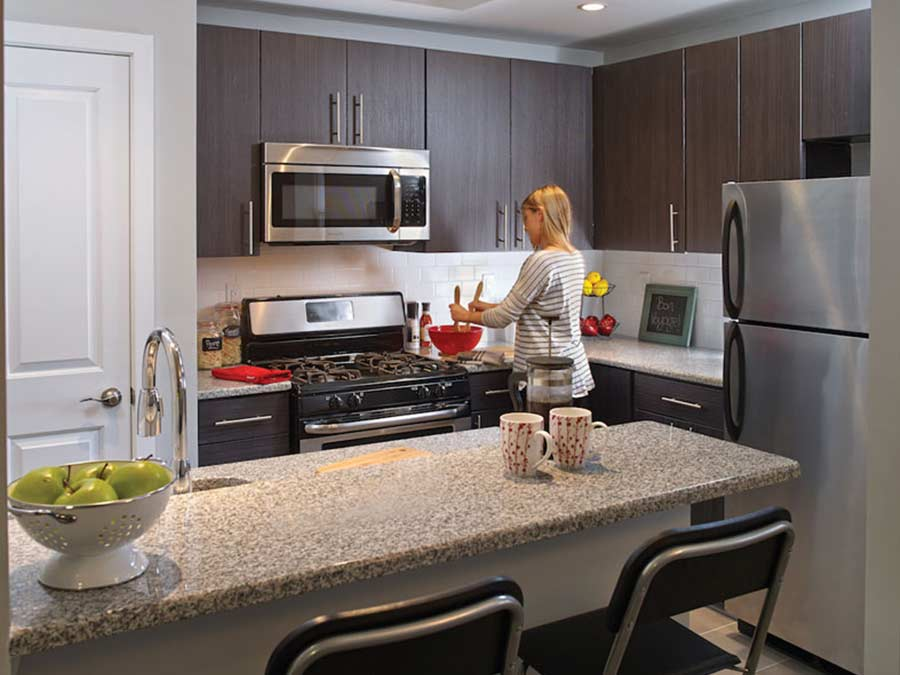 Rock Hill Apartments woman preparing dinner in the kitchen