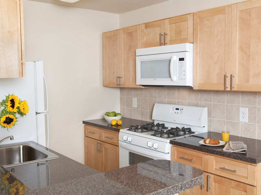 Sedgwick Station kitchen with new white appliances